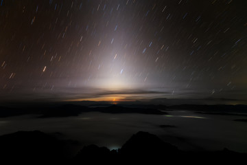 Landscape of Mountains at Night with Stars Trails in Thailand