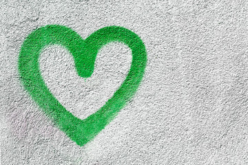 Green heart on wall
