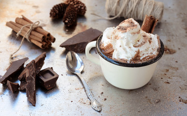 Foto op Canvas Chocolade Cup of hot chocolate cocoa with whipped cream and dark chocolate slices on vintage metale background. Delicious cold weather beverage concept.