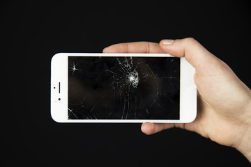 The cracked screen is in the hand