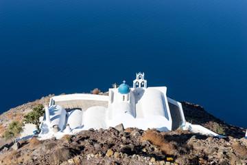 Small orthodox church in the rock on the island Santorini