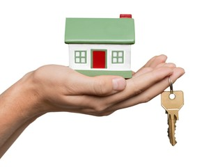 Hand Holding a Model House and Keys