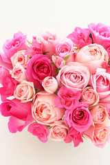 Heart shaped bouquet of beautiful pink rose flowers