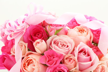Bouquet of beautiful pink rose flowers with pink bow