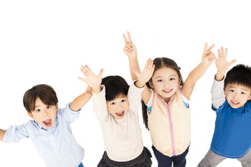 Group of happy children with hands up.