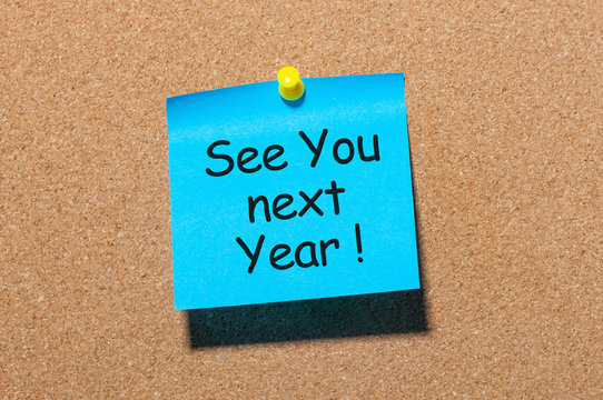 phrase See you next year pinned at cork board