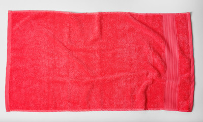 Soft terry towel on light background, top view