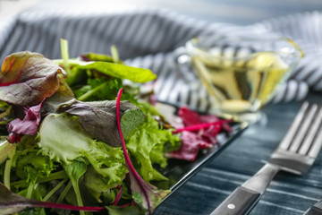 Plate of fresh salad on wooden table, closeup
