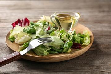 Plate of fresh salad on table