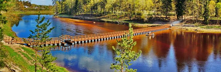 Poster Bridge Panoramic view of pedestrian bridge on pontoons (Ogre, Latvia)