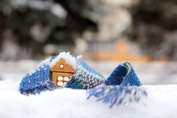 home atmosphere warming cold winters/ wooden house in the winter scarf