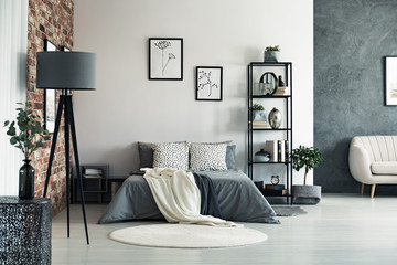 Spacious bedroom with grey lamp