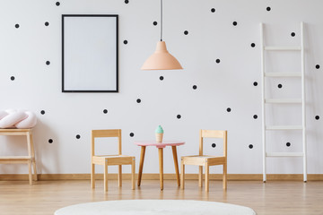 Dots wallpaper and wooden furniture