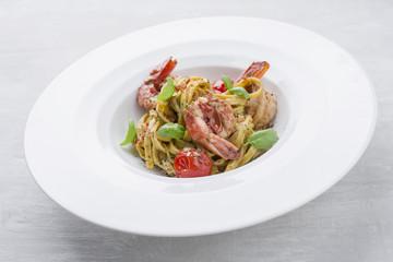 Traditional Italian tagliatelle ai gamberoni with tomatoes as close-up on a plate