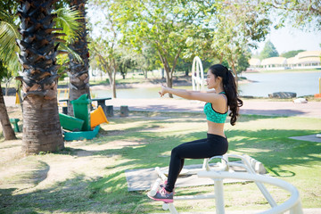 Asian slim woman warm up before work out,slim girl exercise for life,Thailand people,Stretching body before jogging