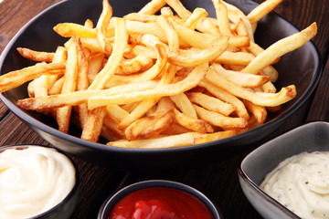 Red and white french fries chips with ketchup and mayonnaise