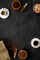 Coffee concept. Roasted beans, ground coffee, cup of espresso and sugar on black background top view copyspace