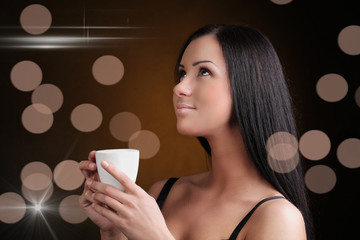 Beautiful Woman with cup of Coffee