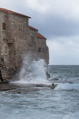 Wave is fighting in the old wall of fortress in Montenegro