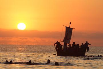 Barco al amanecer desembarco