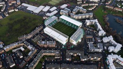 Edinburgh, UK - DECEMBER 23 : Hibernian FC Easter Road Football Stadium on December 23, 2017. Flying Over Aerial View Iconic Stadium in Edinburgh, Scotland. Home of Scottish Premiership Club
