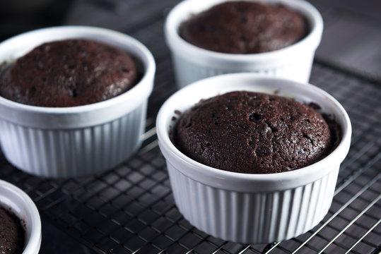 Chocolate lava cakes, Molten lava cakes, dark chocolate cake on dark wooden background