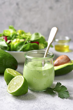 Homemade avocado yogurt dressing in a vintage glass jar.
