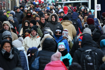 People bundle up against the cold temperature as they walk in Times Square in New York