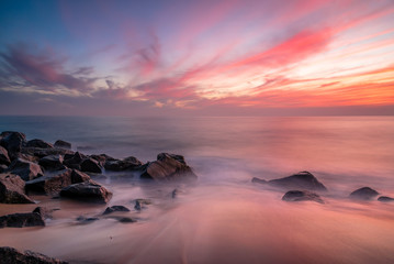 Misty water over rocky beaches