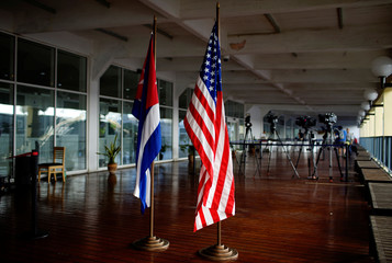 U.S. and Cuban flags are seen before a ceremony for the arrival of Carnival cruise ship ms Veendam during its first trip to Cuba in Havana, Cuba