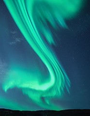 Green Northern Lights in dramatic S-shape