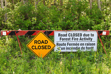 A road closed due to fire activity sign