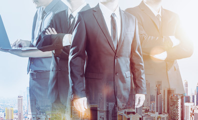 Business partner team standing together , double exposure effect with cityscape  .