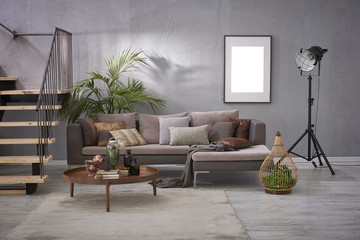 luxury grey living room decoration style with grey sofa lamp and stairs