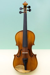 Musical instrument violin on a colored background
