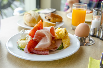 Bright and healthy breakfast, raw vegetables salad, fresh lettuce, cheese shakes, Western fried egg with the original bread,