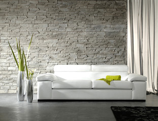 grey stone wall living room white sofa and green details decoration home design