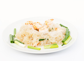Stir--fried glass noodles with shrimp and vegetable .