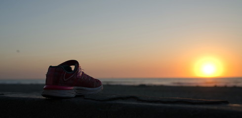 Lost running shoe highlighted by sunset at Mission Bay