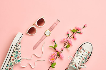 Fashion Woman Accessories Set. Pink Pastel Color. Flat lay. Minimal Style. Trendy fashion Sneakers, Glamour Summer Sunglasses. Blossom Flowers. Spring Floral