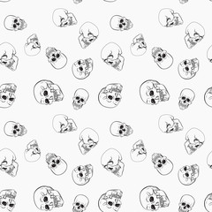 Dark skulls on white background vector pattern