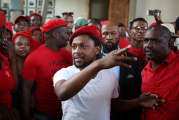The Economic Freedom Fighters spokesperson Dr Ndlozi gestures outside the Constitutional Court in Johannesburg