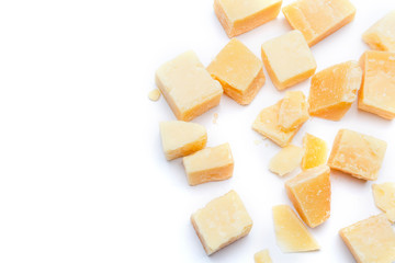 Small pieces of parmesan cheese on white background