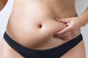 Woman's fat belly
