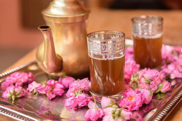 Tea decorated with roses flowers