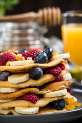Healthy brunch with pancakes and juice.