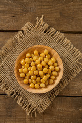 chickpeas on wooden surface