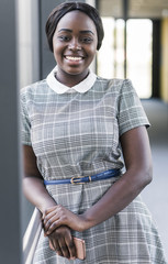Portrait of smiling young woman on office floor
