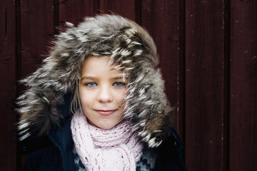 Portrait of girl in fur hood