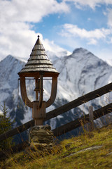 Woody belfry with mountains on backround, Austria